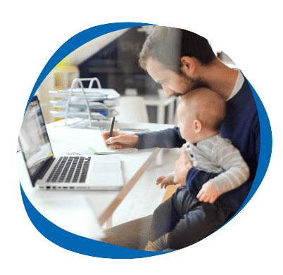 Man studying at laptop with baby