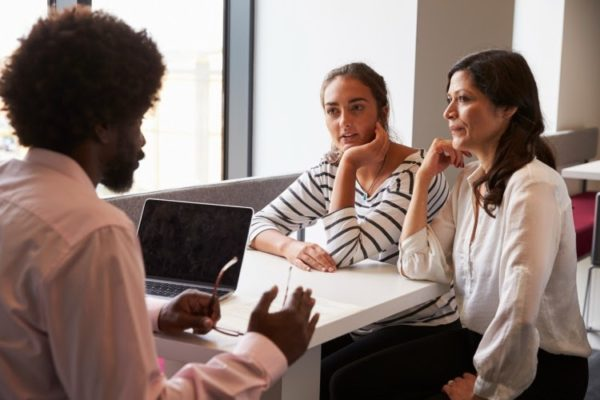 An education consultant working in private practice meets with a high school student and her mother.