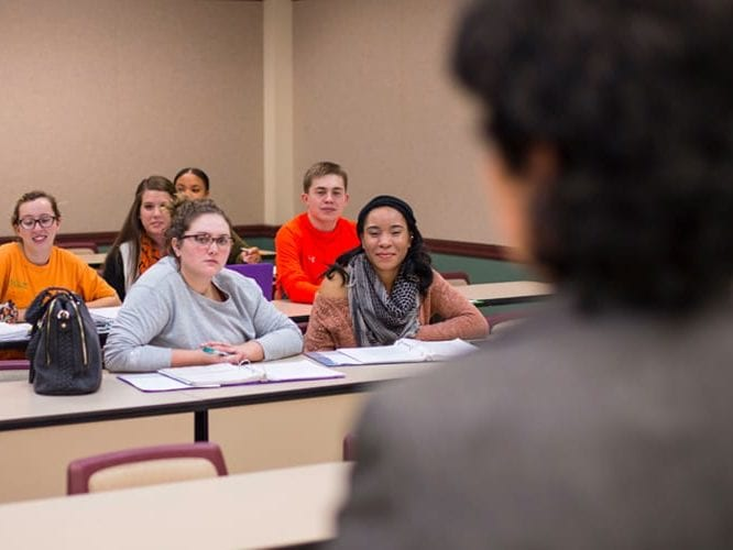 Students in a classroom listening to a lecture