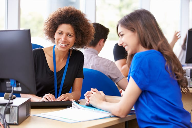An advisor and a nursing student discussing a plan