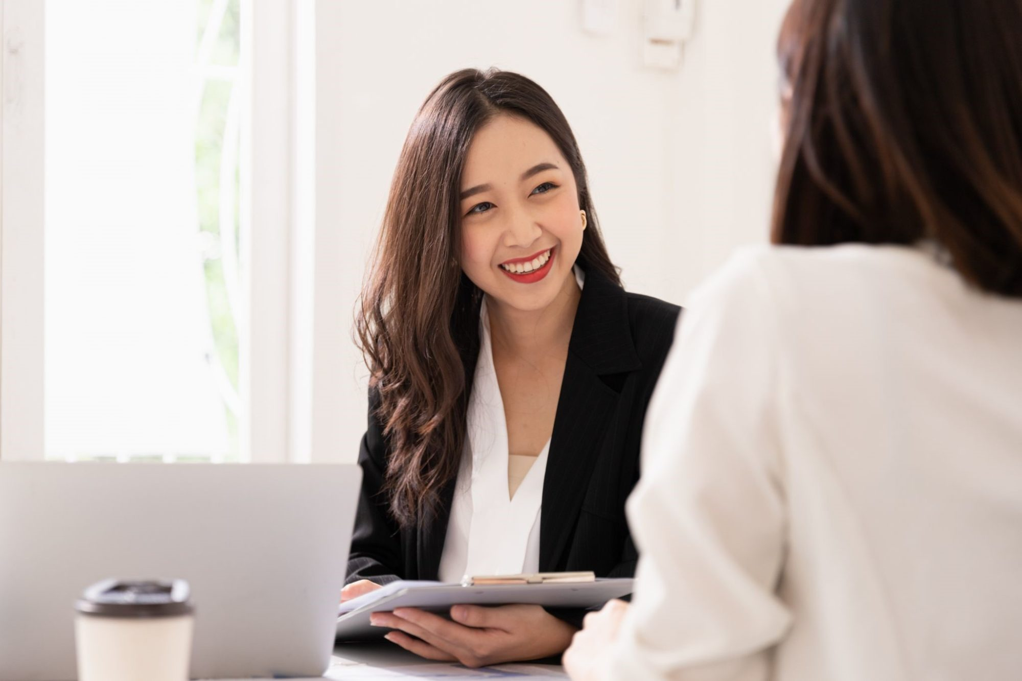 A human resource manager is interviewing an applicant for an open position.